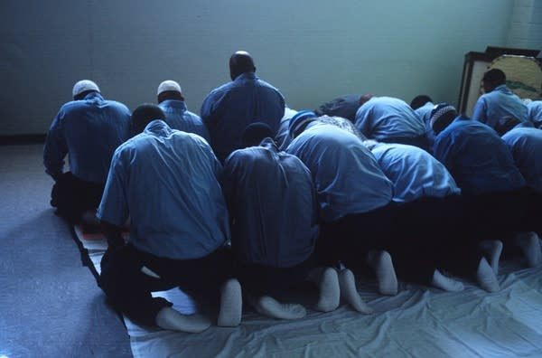 Muslim prisoners hold a Friday afternoon prayer in a Va. state prison.