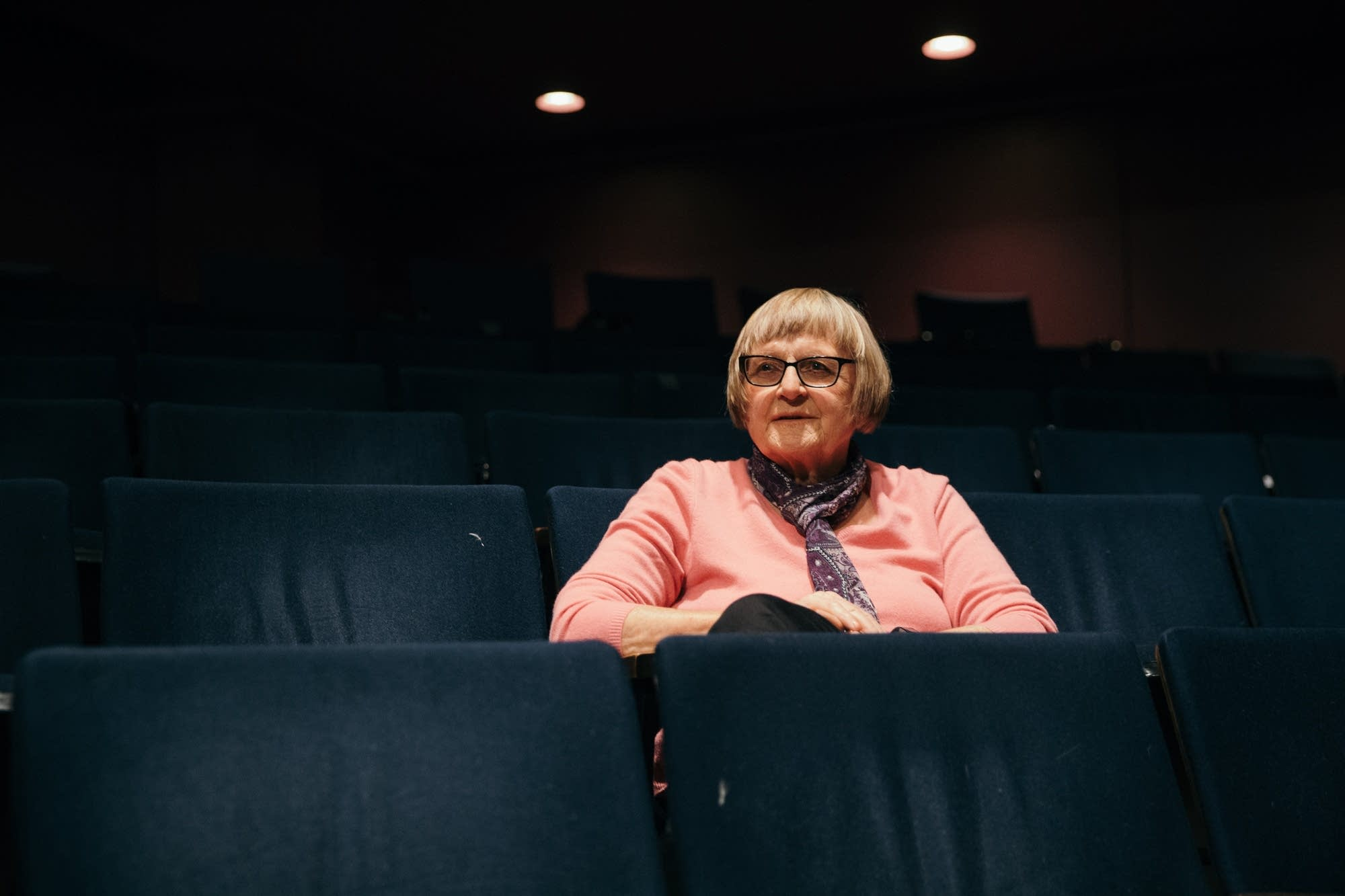 Susan Kimberly sits for a portrait inside of the History Theater.