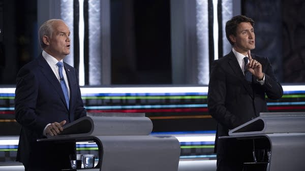 Two people take part in a debate