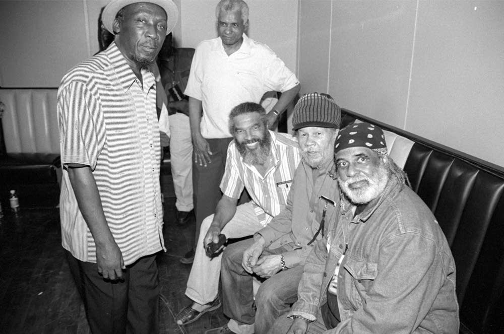 Vintage ska performers chilling out backstage