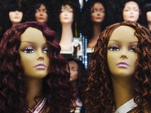 Wigs sit on mannequin heads inside Bella Beauty and Hair.