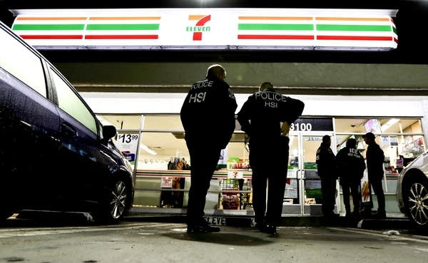 U.S. Immigration and Customs Enforcement agents at 7-Eleven