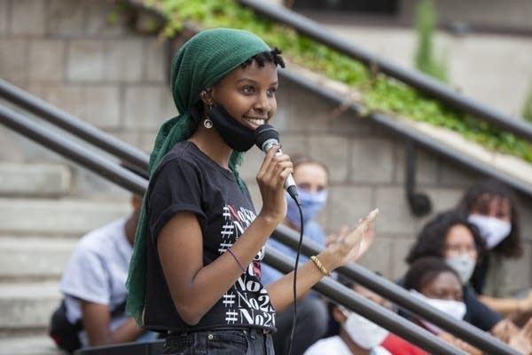 Miski Omar, 19, speaks at a rally.