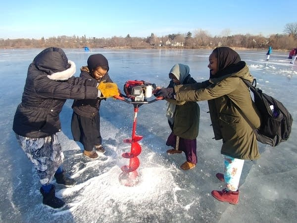 Seventh graders at the Higher Ground Academy ice fish on Como Lake.
