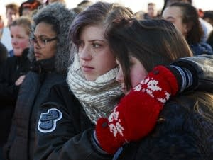 Evelyn Ryan, left, and Jordan Nelson, right, embrace.
