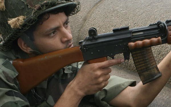 An Indian army soldier holds position ou