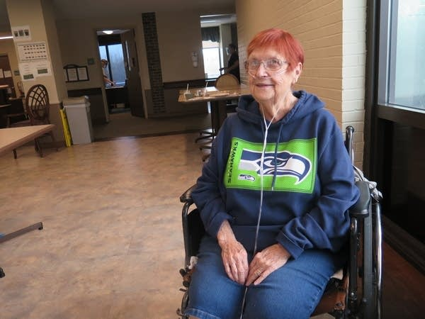 A woman sits in a wheelchair