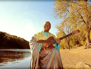 Siama Matuzungidi sitting by the Mississippi.