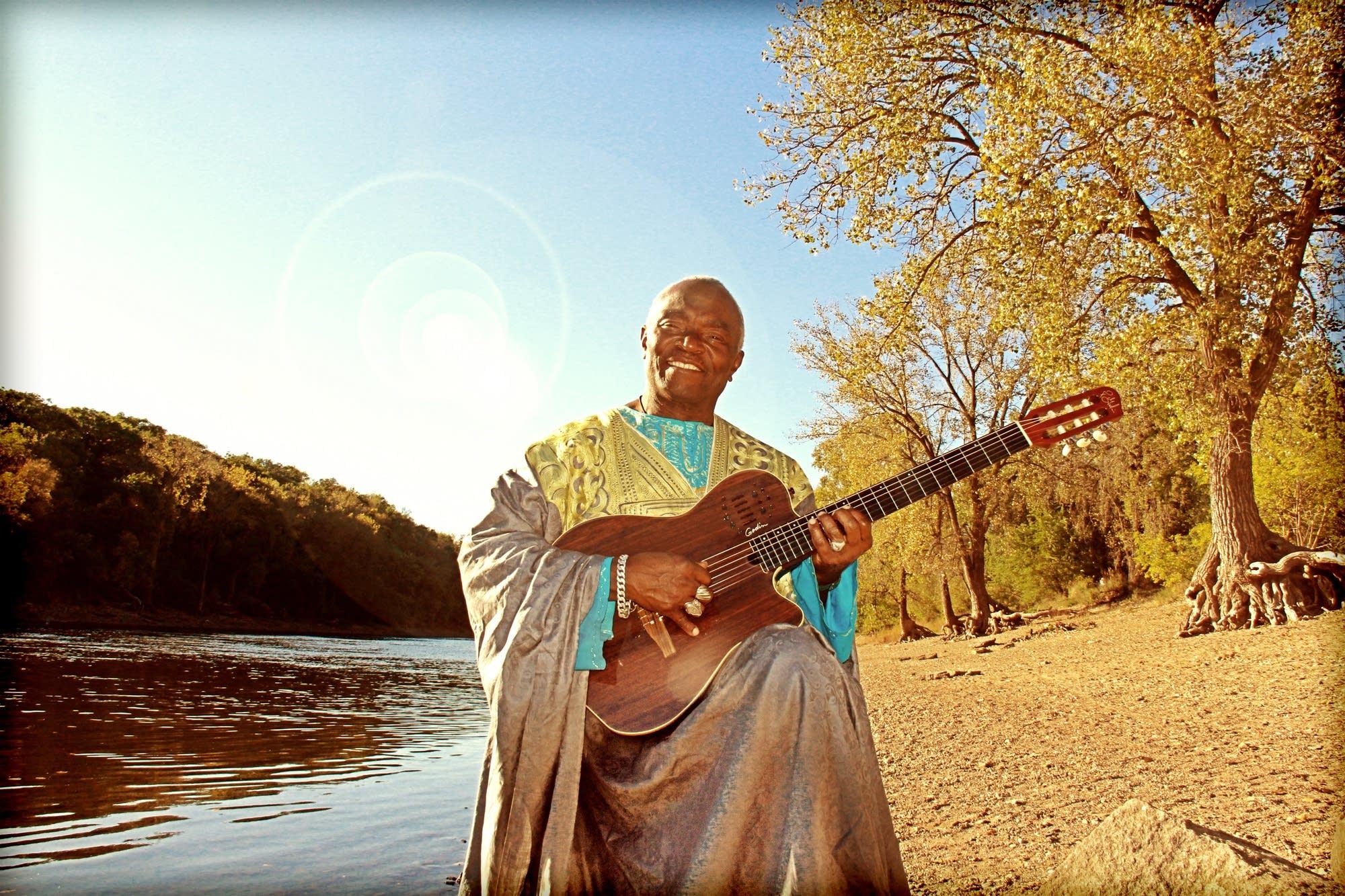 Siama Matuzungidi sitting by the Mississippi.