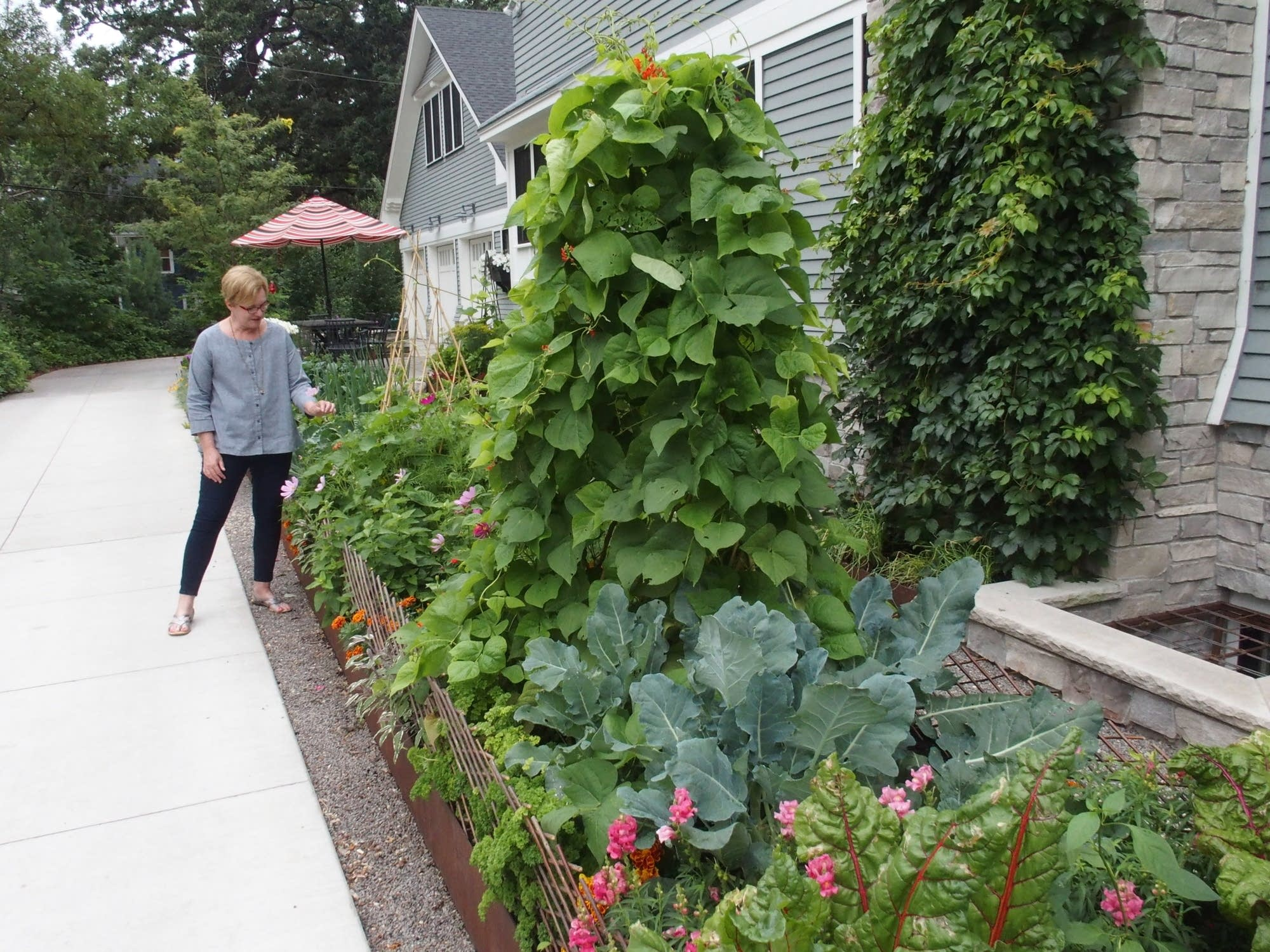 Rhonda Fleming Hayes stands by her kitchen garden
