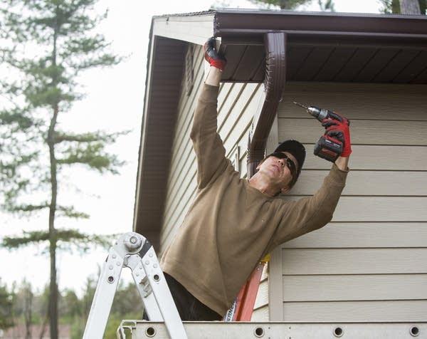 Randy Zacher installs gutters