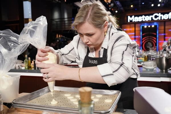 A woman competes in a cooking competition