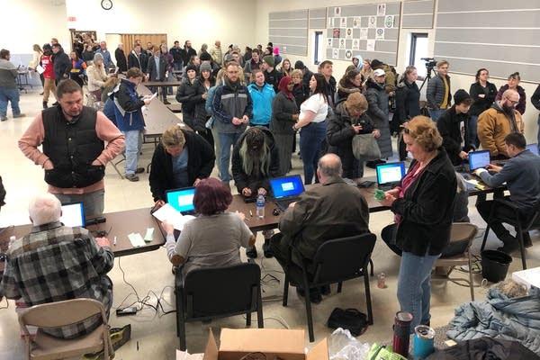 Voters wait in line for the North Dakota Democratic presidential caucus.