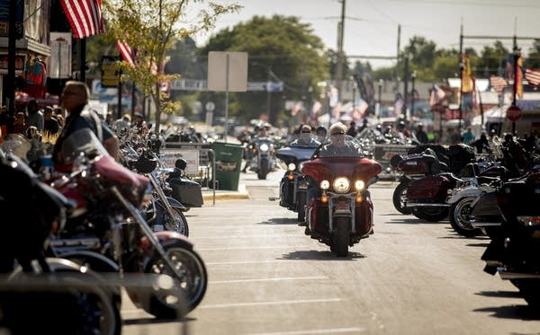 People ride through downtown Sturgis