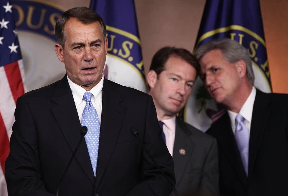 Boehner delays debt vote