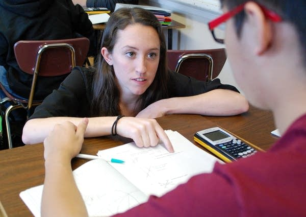 Alexandra Schmitz works with a math student.