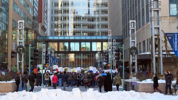 People gather to protest the immigration executive order in Rochester.