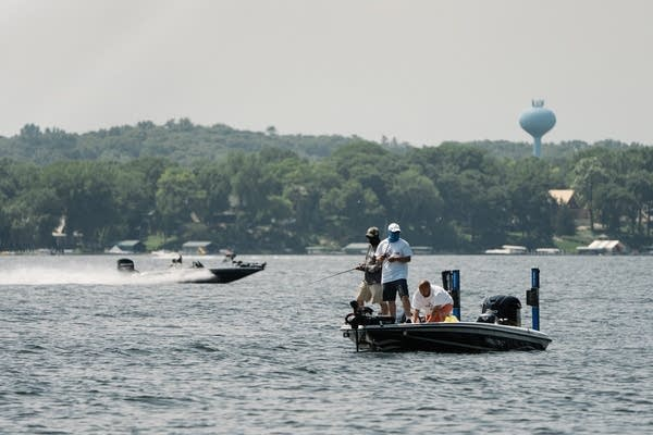 A team races across Lake Minnetonka to get back in time for their weigh-in.