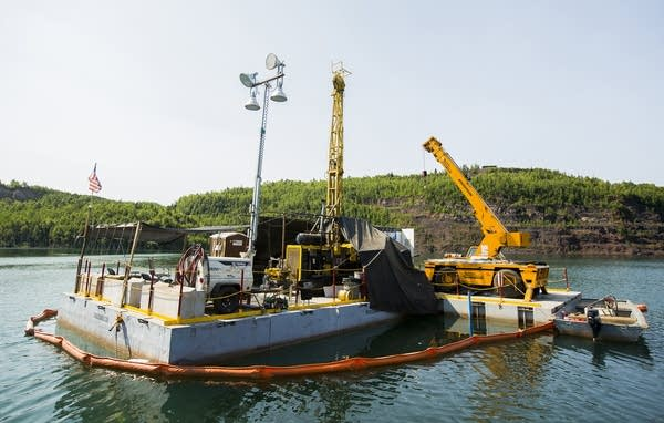 A floating barge collects core samples.