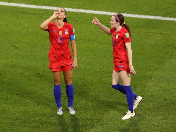 "Alex Morgan of the U.S. celebrates by ""sipping tea"""