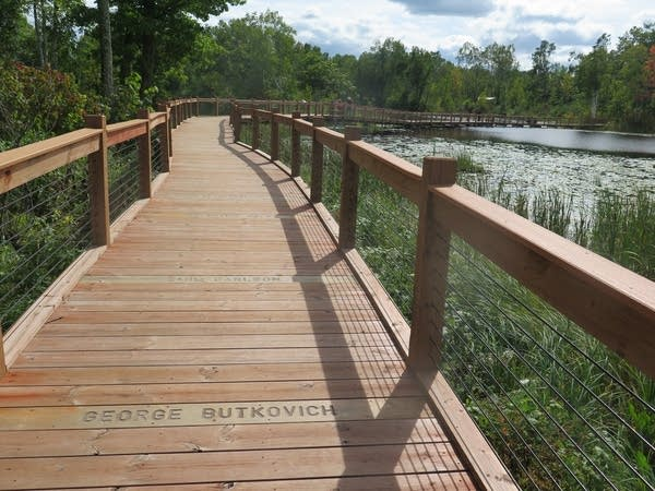 A boardwalk crosses Milford Lake, which filled in after the mine closed.