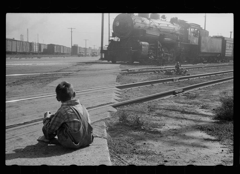 Child watching train