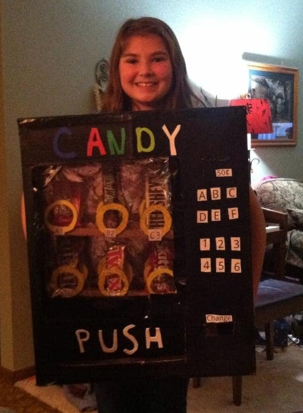 A young girl in a vending machine costume.