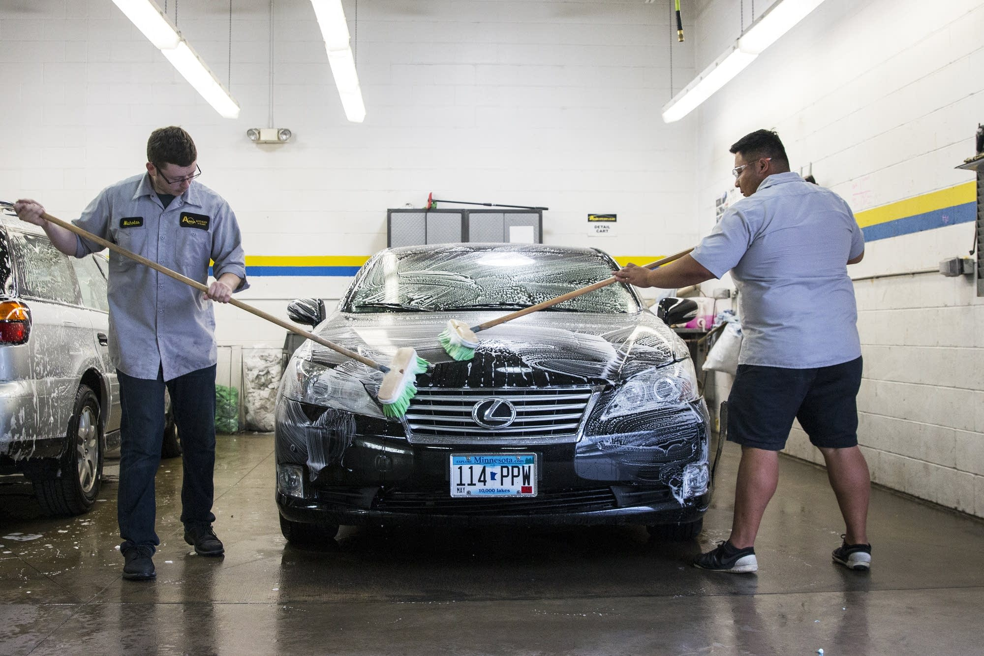 Abra Employees Wash A Lexus.