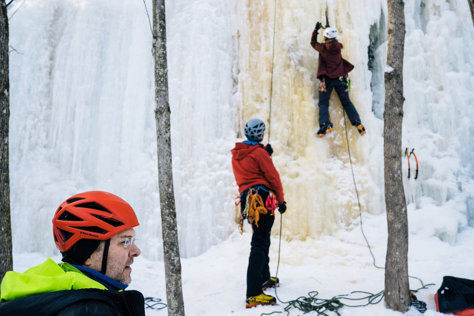 James Loveridge, left, helps beginner ice climbers learn the ropes.