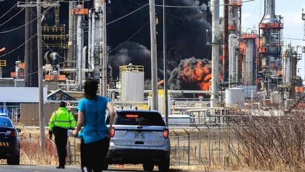 A large fireball erupts in a series of fires and explosions at the refinery