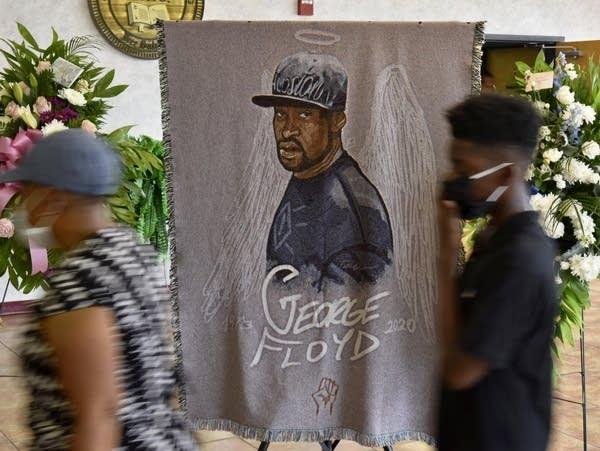 People pay their respects during a memorial service for George Floyd