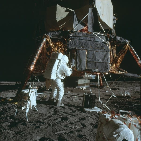 Astronaut Alan  Bean removing an experiment at the landing site