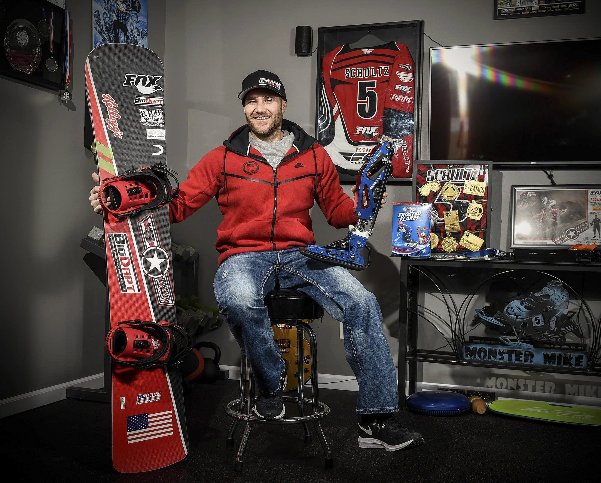 Mike Schultz poses for a photo in his shop.