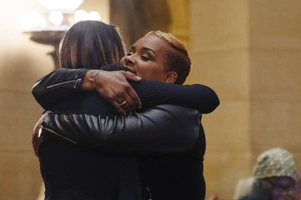 Pastor Marea Perry hugs Rep. Lindsey Port