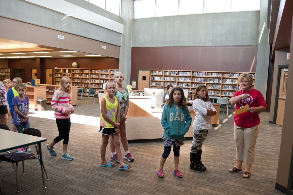 Fifth-graders tour the new library.