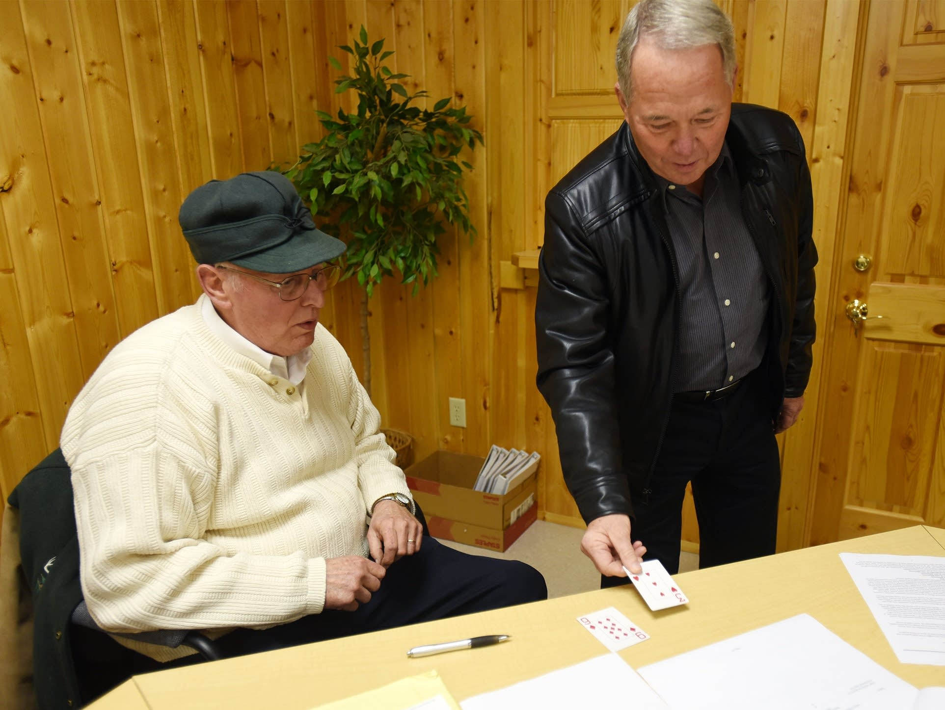 Larson laid down his card next to incumbent mayor Allen's winning card.