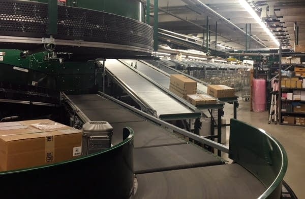 Packages of filled orders roll off a conveyer belt at Digi-Key.