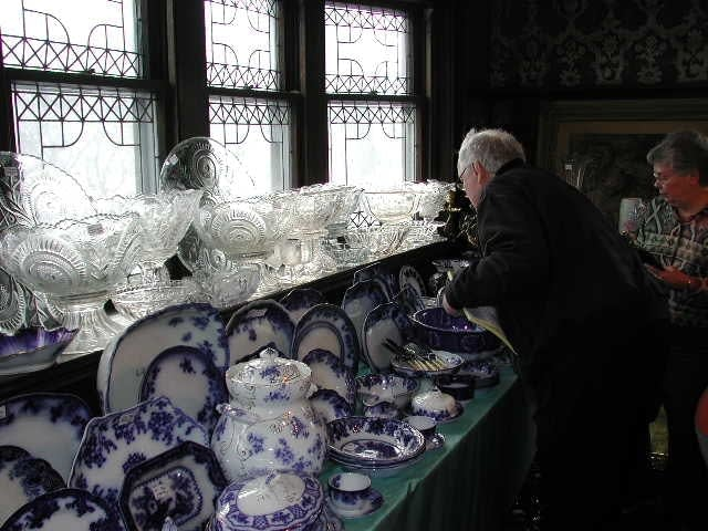 A collector pores over some of the items for sale