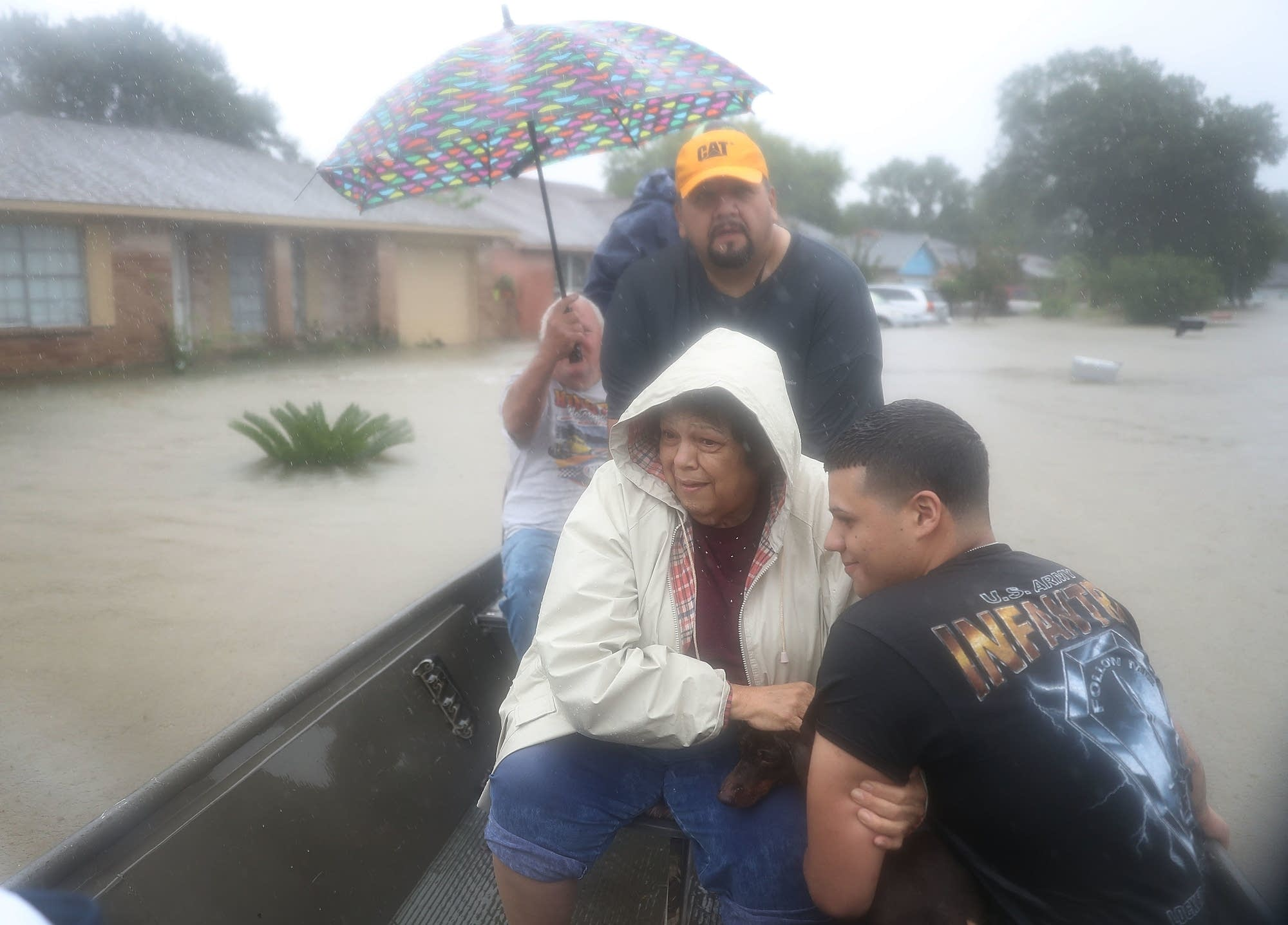 People  evacuate after flooding from Hurricane Harvey.
