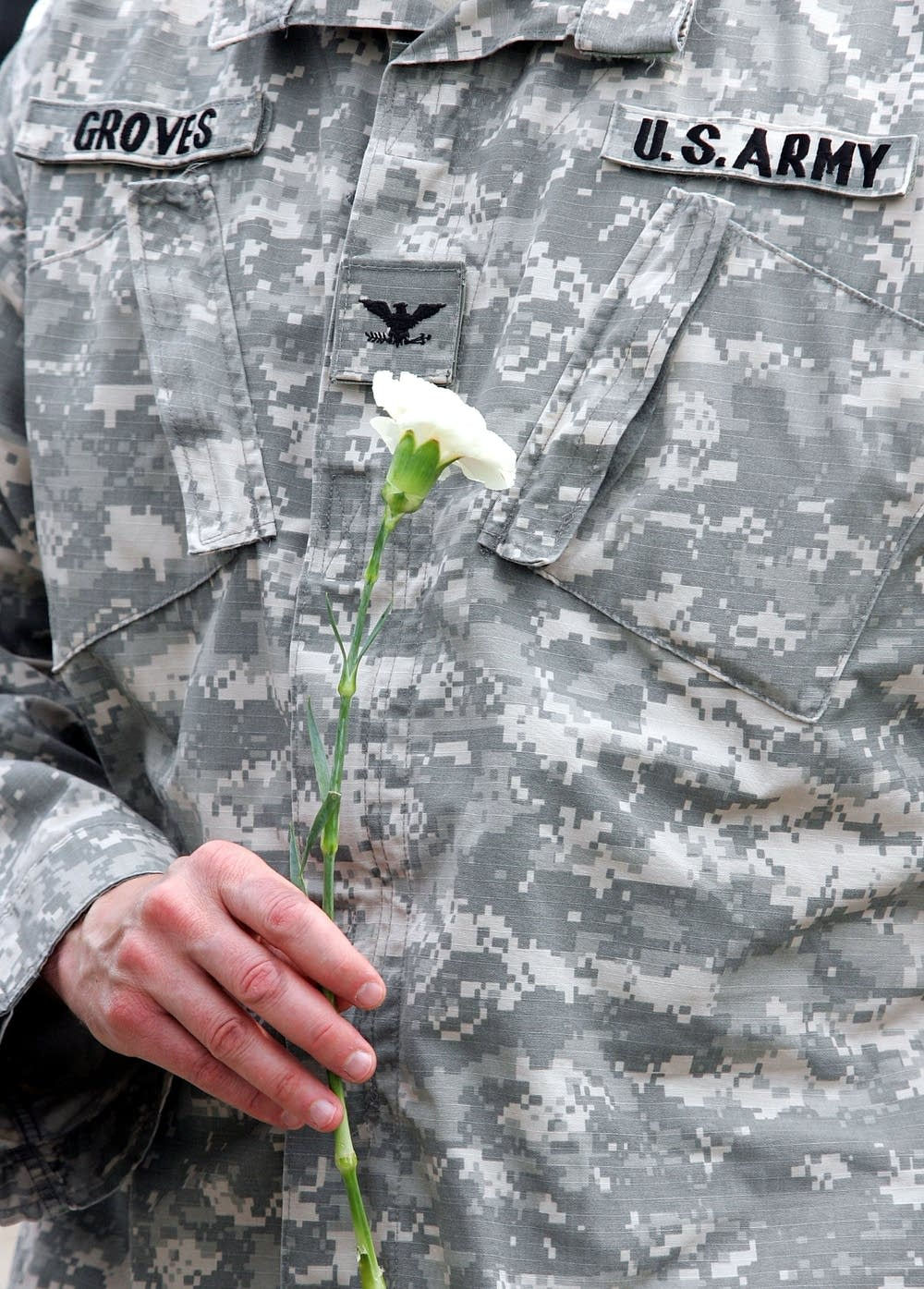 A U.S. soldier holds a flower