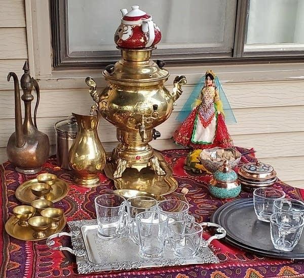 a traditional Iranian tea setup with a samovar and tea cups