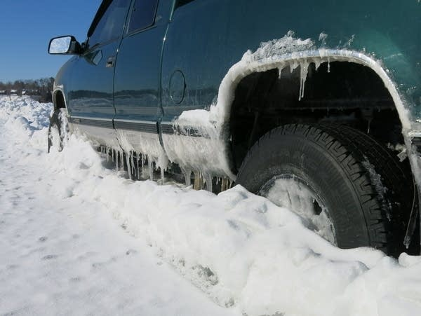 This truck is frozen in place on Leech Lake