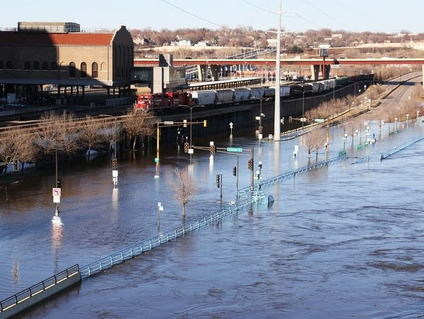 A stretch of Shepard and Warner roads in St. Paul is inundated