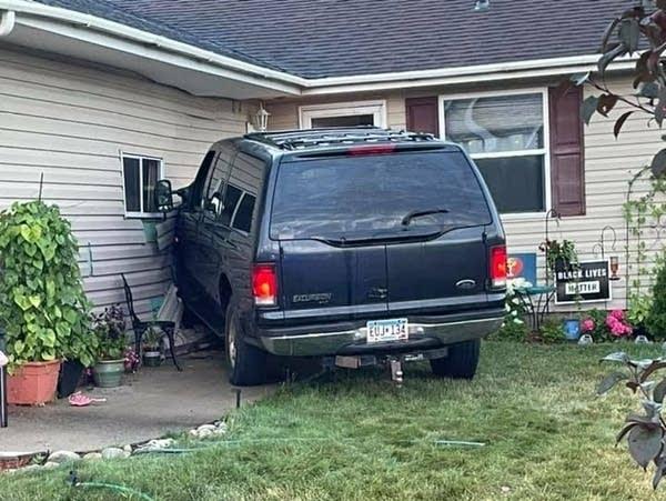car crashing into a home