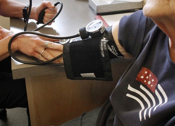 A patient has her blood pressure checked.