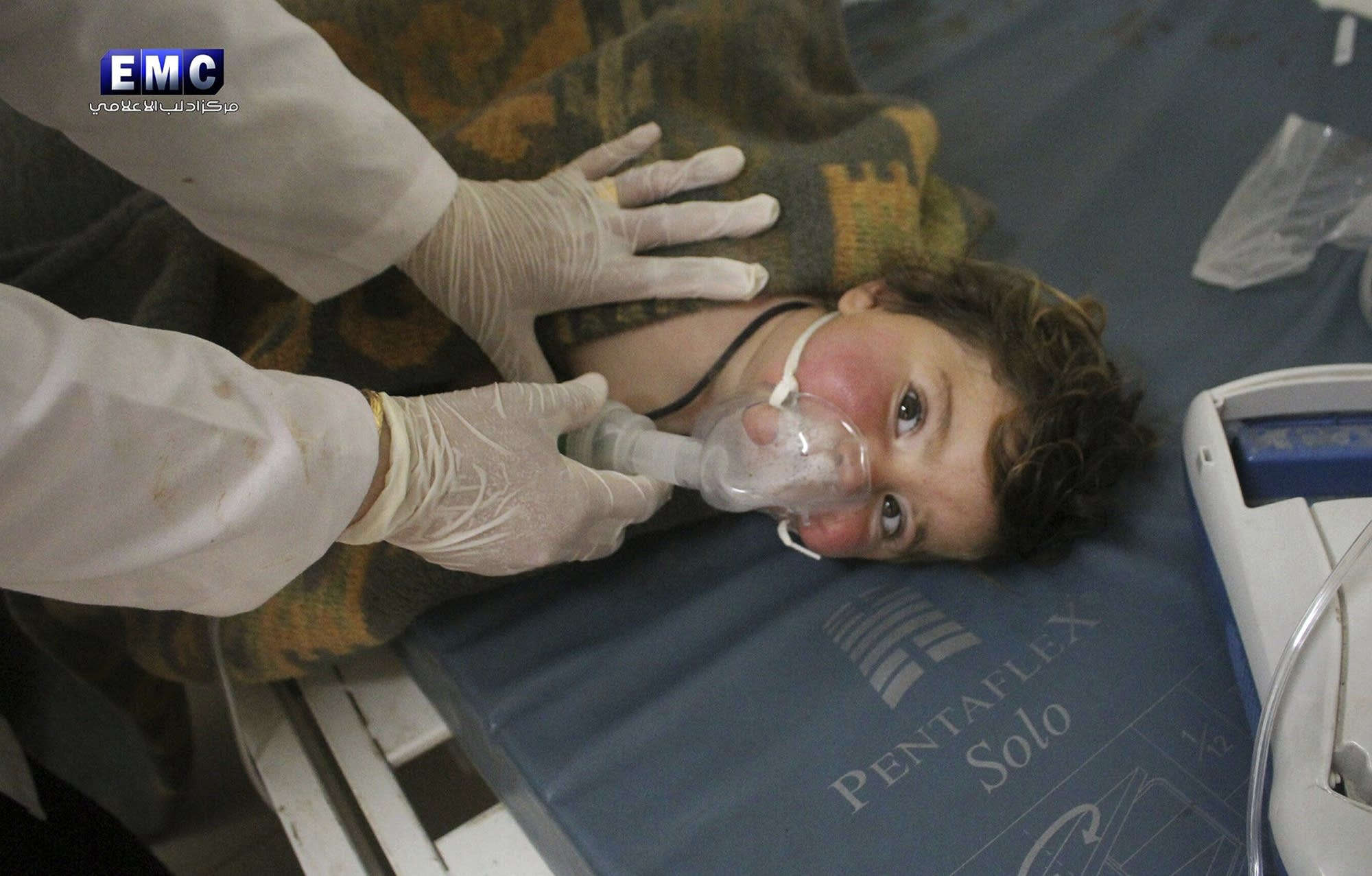 A Syrian doctor treating a child following a suspected chemical attack