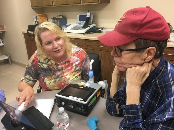 Jolene Hyppa Martin shows Richard Harri how to record messages.