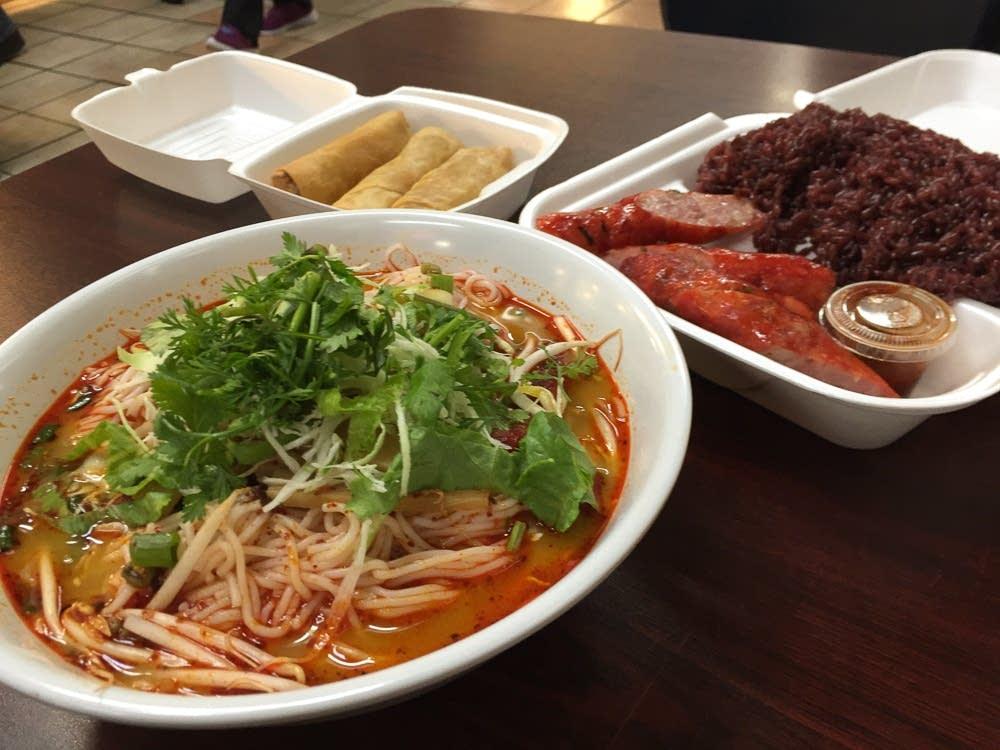 Khaub poob, Hmong sausage, purple rice, egg rolls