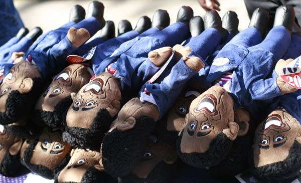 A stack of Obama dolls ready for sale