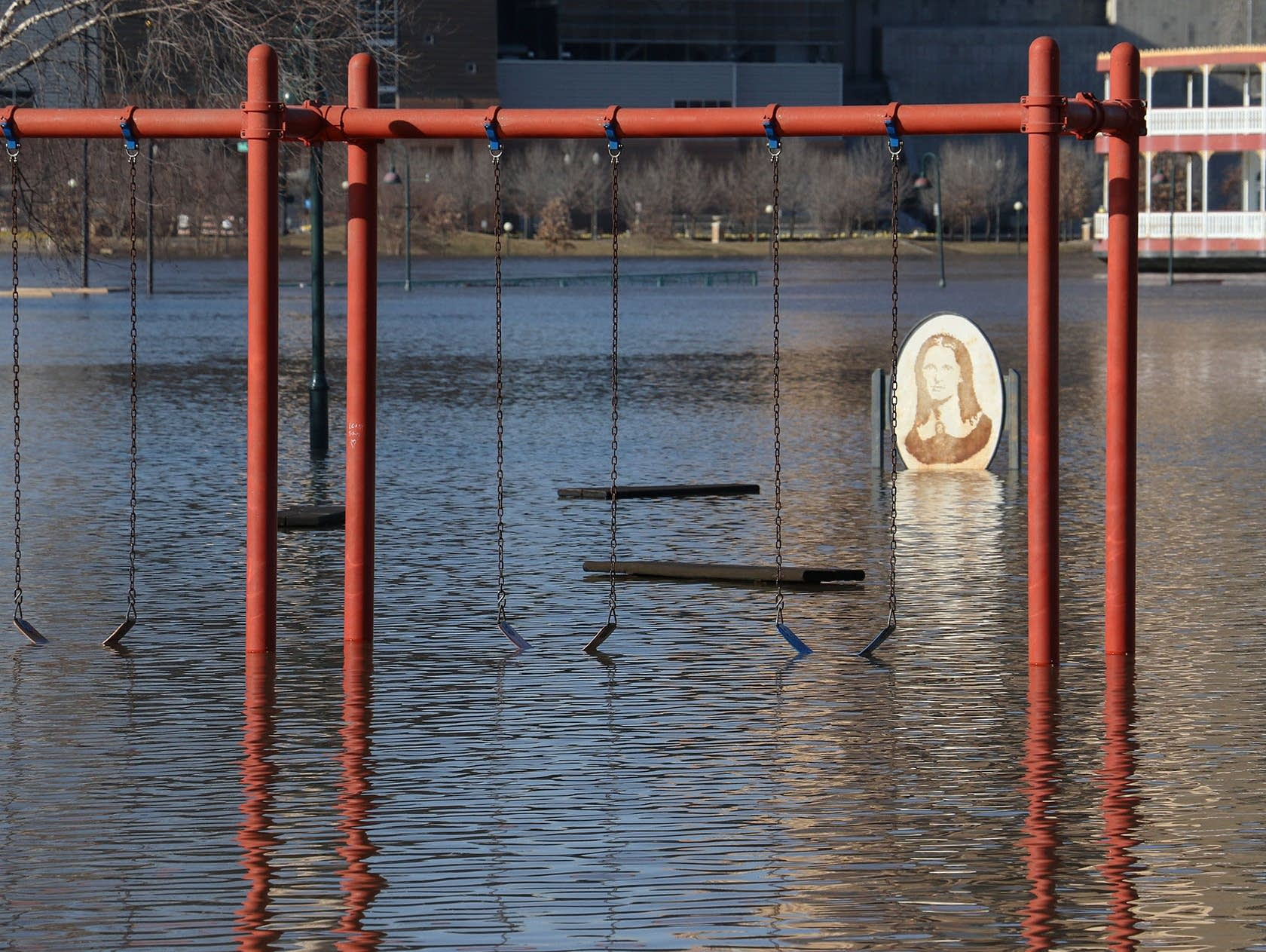 Mississippi River floodwaters reach the bottom of the swings